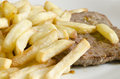 Beefsteak and french fries close up picture of a with Stock Photo