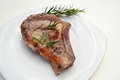 Beefsteak with rosemary on table Stock Photos