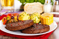 Beefsteaks with grilled veggies pieces of fresh sliced corncob potatoes and Royalty Free Stock Image