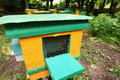 Beegarden. a one old beehive in focus. Stock Photos