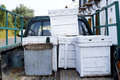 Beehives in the back of a truck white wooden green pick up Stock Photography