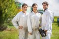Beekeepers standing at apiary team of happy male and female Royalty Free Stock Image