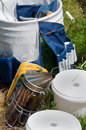 Beekeeping Equipment: Smoker & Pails Royalty Free Stock Image