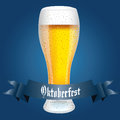 Beer abstract and oktoberfest text on special blue background Royalty Free Stock Images