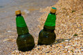 Beer on beach Stock Photography