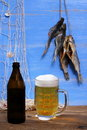 Beer on blue background dried rudd fish mug of with fishing net Stock Images