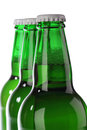 Beer bottle with drops isolated on white Stock Images