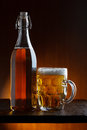 Beer bottle and mug Royalty Free Stock Photography