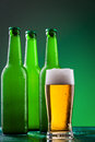 Beer bottles with full glass Royalty Free Stock Photos