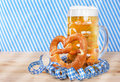 Beer with brezel and paper streamers