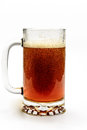 Beer bubbling in beer mug golden foaming on white background Royalty Free Stock Photography