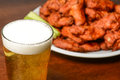 Beer and buffalo wings spicy chicken Stock Photos