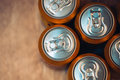 Beer cans on rustic wooden table top view Royalty Free Stock Photo