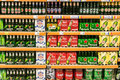 Beer Cans On Supermarket Shelf Royalty Free Stock Photo