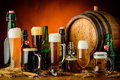 Beer drinks still life with different bottles glasses and mugs of Royalty Free Stock Image