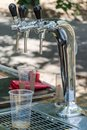 Beer faucet and plastic empty glass Royalty Free Stock Photo