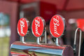 Beer faucets with red plates Bud beer closeup. Royalty Free Stock Photo