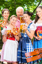 Beer garden friends drinking in bavaria pub men and women tracht dirndl and lederhosen a fresh germany Stock Image