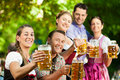 In Beer garden - friends drinking beer Royalty Free Stock Photo