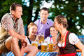 In Beer garden - friends drinking beer Stock Photography