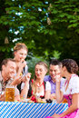 In beer garden friends on a table with beer tracht dirndl and and snacks bavaria germany Stock Images