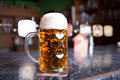Beer glass on a bar table. Closeup Royalty Free Stock Photo