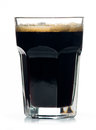Beer glass full of cold black irish stout. Royalty Free Stock Image