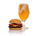 Beer glass and hamburger on white Stock Images