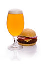 Beer glass and hamburger on white Royalty Free Stock Photo