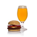 Beer glass and hamburger on white Royalty Free Stock Image