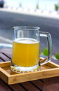 Beer glass with sea on background Royalty Free Stock Photo