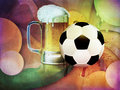 Beer glass and soccer ball mug of football on abstract background Stock Photography