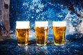 Beer glasses, draught light beers served in pub, restaurant or nightclub Royalty Free Stock Photo