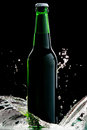 Beer in green bottle with water splash isolated Stock Photography