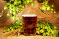 Beer and hop on sacking Royalty Free Stock Photo