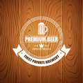 Beer logotype for beer house, brewing company, restaurant, pub, bar on wood background Royalty Free Stock Photo