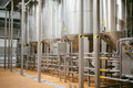 Beer manufacture line. Equipment for staged production bottling of Finished food products. Metal structures, pipes and tanks at en Royalty Free Stock Photo
