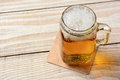 Beer in a mason jar high angle closeup of full of on rustic wood table Stock Photos