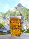 Beer in mountain scenery Stock Photography