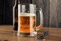 Beer mug and beer bottle a a of with froth slight spill Royalty Free Stock Photography