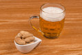 Beer peanuts wooden bar counter Stock Images