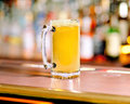 Beer pint full glass of on a colorful bar background Royalty Free Stock Image