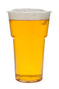 Beer in a plastic cup isolated on a white background Royalty Free Stock Photo