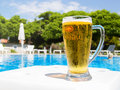 Beer by the pool Royalty Free Stock Photo