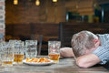 Beer pub drink responsibly portrait of drunk man sitting at the with his eyes closed Royalty Free Stock Image