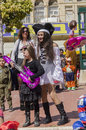 Beer sheva israel march girl in a black dress with a pink inflatable guitar and a girl in a white dress in pirate hat purim Stock Photography