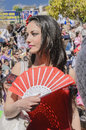 Beer-Sheva, ISRAEL - March 5, 2015:Girl in a scarlet dress with red fan in the style of Carmen -Purim