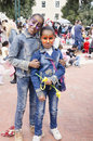 Beer-Sheva, ISRAEL - March 5, 2015: Two dark-skinned teen girl in denim dress with butterflies makeup on their faces - Purim Royalty Free Stock Photo