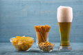 Beer and snacks, chips, bread sticks and peanuts Royalty Free Stock Photo