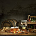 Beer still life on the table with old kegs tap Royalty Free Stock Image